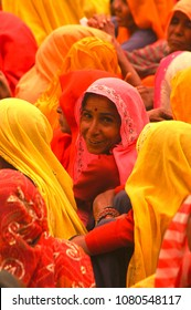 Rajasthan, India - march 3, 2006: Selective focus of a peasant girl smiling at a citizens meeting in the village of Nayla Fort