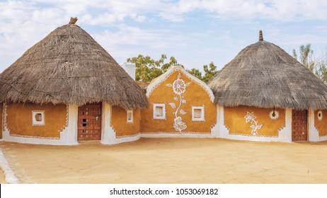 Rajasthan village near Thar desert Jaisalmer with mud huts and painted walls