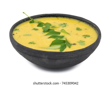 Rajasthani And Gujarati Traditional Cuisine Kadhi - Indian Vegetarian Curry Made of Buttermilk And Chick Pea Flour. Cuisine on White Background