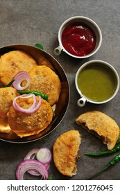 Rajasthani Kachori served with green Chutney / Indian Diwali snacks overhead view