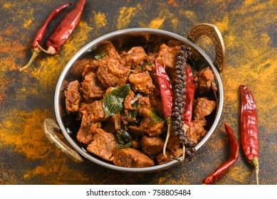Rajasthani Laal Maas hot and spicy mutton or goat curry soup perpared using Kachri spice India. Popular Indian  non-vegitarian recipe.