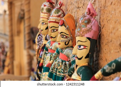 Rajasthani puppets (Kathputli) have been displayed on a shop at Jaisalmer Fort, Rajasthan. Kathputli is a string puppet theatre, native to Rajasthan, India, and is the most popular form of Indian
