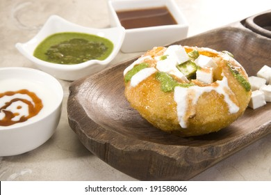 Rajasthani Shahi Raj Kachori, stuffed katchori with cheese and sprout filling and served with curd, chutney