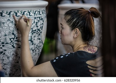 RAJBURI THAILAND 20 JAN,2016  Woman painting on small water jar from the soil. To bring it into the hot furnace. Used to put water Ratchaburi Province thailand, January 20, 2016