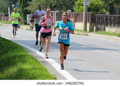 RAJEC, SLOVAKIA - AUGUST 10, 2019: Michaela Filinova (number 814) during Rajec half marathon which was part of Rajecký maratón 2019. She run in t-shirt of foundation Anjleské krídla.
