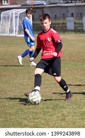 RAJEC, SLOVAKIA - MARCH 23, 2019: Young footballer during league kids football match between teams FK Rajec and FK Slavia Staskov in category U15. FK Slavia Staskov (in red) won this match 0:4.