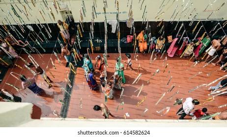 RAJGIR, INDIA - NOVEMBER 12: Hindi ancient public bath in India NOVEMBER 12, 2015 in Rajgir. Locals taking bath at multilevel bath place of Tapodharama Hot Springs Public Bath in Rajgir.