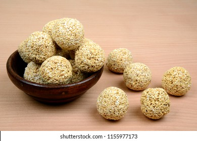 Rajgira Laddu , Cholai ke Laddo or Amaranth Ladoo in a wooden bowl on wooden background