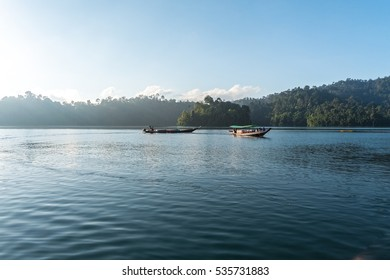 Rajjaprapha Dam, Suratthanee, Thailand have long tail boat for take tourists traveling to see the mountains in water in dam