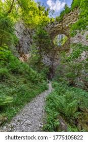 Rak river flowing under the small bridge (Mali Most)  through the cave in Rakov kocjan gorge, Slovenia