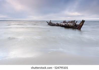 "The ""Raketa"" ship wreck on the Loksa beach in Estonia. The ship was built in 1949 in Finland"