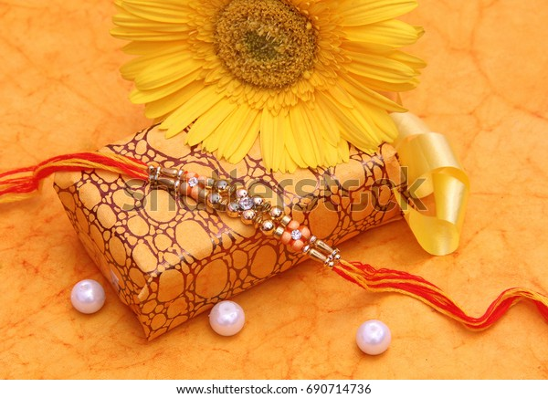 rakhi with a gift box on the occasion of rakhsa bandhan a famous indian festival that is a symbol of bonding