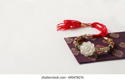 Rakhi (Lumba) on white background, Raksha Bandhan Indian festival specially for brother and sister