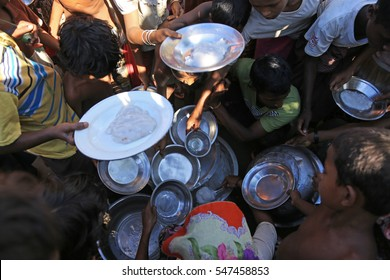 RAKHINE STATE, MYANMAR - NOVEMBER 05 : Rohingya people are receiving food from donations, on NOVEMBER, 2015 in Sittwe, Myanmar.