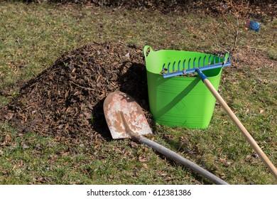 raking leaves in spring