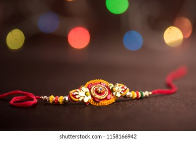 Raksha Bandhan background with an elegant Rakhi. A traditional Indian wrist band which is a symbol of love between Brothers and Sisters.
