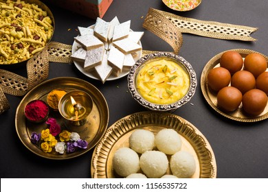 Raksha bandhan greetings : Sweet food like Gulab Jamun, Rasgulla, Shrikhand, Bundi Laddu, Kaju Katli and farsan with Pooja thali for Rakhi Festival Celebration