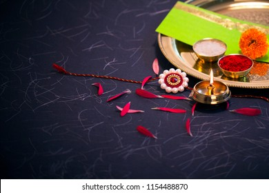Raksha bandhan Raakhi with sweets gifts flowers and diya