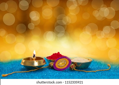 Raksha bandhan rakhi with diya kumkum rice and sweets mithai