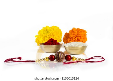 Raksha bandhan rakhi with kumkum decorated with flowers