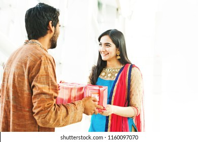 Raksha bandhan (rakhi, rakshabandhan) concept. Indian brother giving gift to his sister