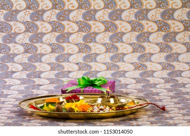 Raksha bandhan thali with diya and rakhi