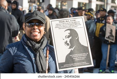 RALEIGH - JANUARY 19: People marched through downtown Raleigh for the Martin Luther King March, on January, 2015 in Raleigh, USA. There was a big crowd and the march was very peacefully.