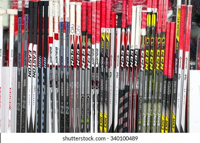 RALEIGH, NC  April 11, 2015: Detroit Red Wings hockey sticks on the bench during the NHL game between the Detroit Red Wings and the Carolina Hurricanes at the PNC Arena.