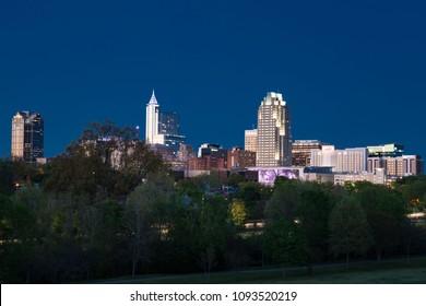 RALEIGH, NC - APRIL 17, 2018: Raleigh, North Carolina Night Skyline from Dorothea Dix Park