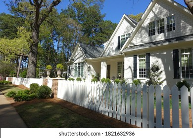Raleigh, NC - April 2020: Charming Home with White Picket Fence
