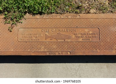 """RALEIGH, NC - April 2021: """"No Dumping"""" Engraved Warning on a Street Drain"""