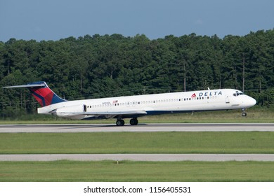 Raleigh, NC / August 12, 2018: A Delta Air Lines McDonnell Douglas MD-88 takes off from Raleigh-Durham International Airport.