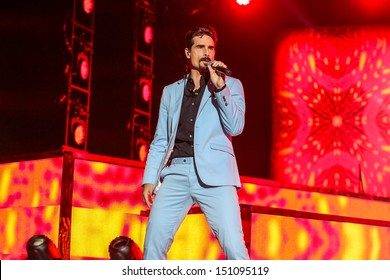Raleigh, NC - August 20:  Kevin Richardson of The Backstreet Boys live in concert on their 20th anniversary and In A World Like This Tour on August 20, 2013 in Raleigh, NC.