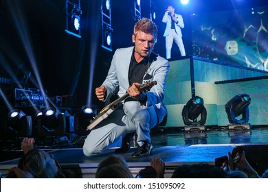 Raleigh, NC - August 20:  Nick Carter of The Backstreet Boys live in concert on their 20th anniversary and In A World Like This Tour on August 20, 2013 in Raleigh, NC.