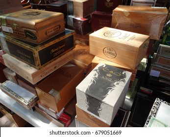 RALEIGH, NC - AUGUST 2013: Cigar boxes piled high at an outdoor flea market