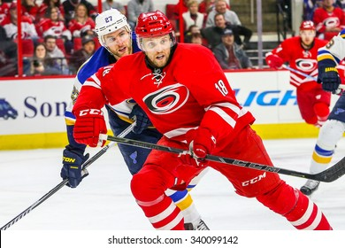 RALEIGH, NC  January 30, 2015: Carolina Hurricanes center Jay McClement (18) and St. Louis Blues defenseman Alex Pietrangelo (27) during the NHL game.