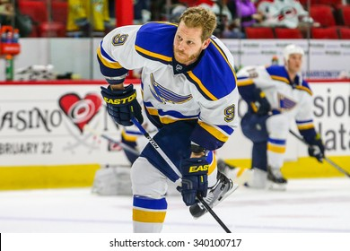 RALEIGH, NC  January 30, 2015: St. Louis Blues center Steve Ott (9) during the NHL game between the St Louis Blues and the Carolina Hurricanes at the PNC Arena.