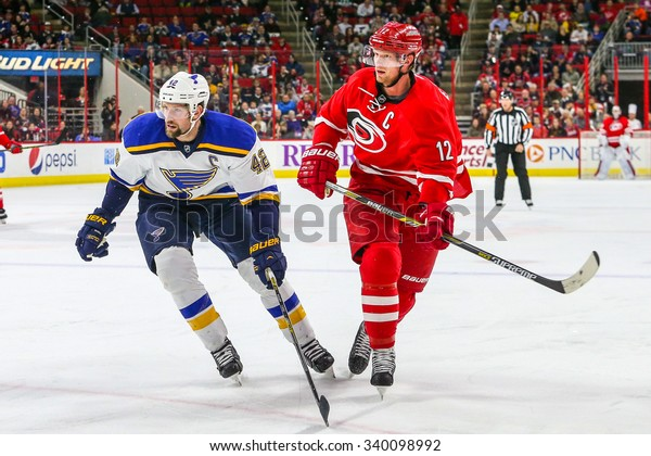 RALEIGH, NC January 30, 2015: St. Louis Blues center David Backes (42) and Carolina Hurricanes center Eric Staal (12) during the NHL game between the St Louis Blues and the Carolina Hurricanes.