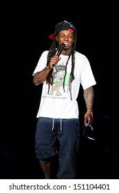 Raleigh, NC - July 27:  Lil Wayne performs in concert as part of his 2013 America's Most Wanted Tour on July 27, 2013 in Raleigh, NC.
