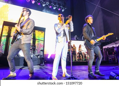 Raleigh, NC - July 31:  The Jonas Brothers perform a concert on their 2013 Jonas Brothers Live Tour on July 31, 2013 in Raleigh, NC.