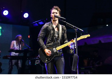 Raleigh, NC - July 31:  Kevin Jonas of The Jonas Brothers perform a concert on their 2013 Jonas Brothers Live Tour on July 31, 2013 in Raleigh, NC.