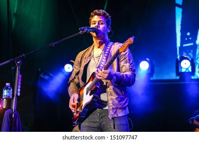 Raleigh, NC - July 31:  Nick Jonas of The Jonas Brothers perform a concert on their 2013 Jonas Brothers Live Tour on July 31, 2013 in Raleigh, NC.