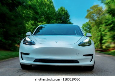 RALEIGH, NC - JUNE 10, 2018: An all electric Tesla Model 3 in Raleigh, NC. The Model 3 is set to be the Tesla's first mass market electric vehicle.