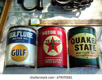 RALEIGH, NC - MAY 2014: Vintage Oil Cans lined up at an outdoor flea market