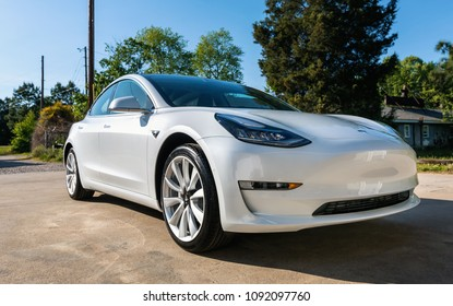 RALEIGH, NC USA, MAY 02, 2018: A brand new white Tesla Model 3. The model 3 is set to be the Tesla's first mass market electric vehicle.