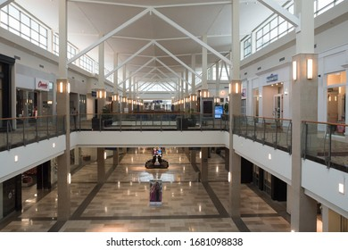 Raleigh, NC/United States- 03/18/2020: The interior of an empty shopping mall. Coronavirus fears and voluntary store closings have kept many shoppers at home.