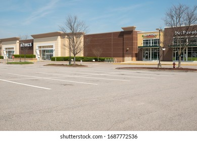 Raleigh, NC/United States- 03/18/2020: The parking lot at a normally bustling strip mall is completely deserted amid the coronavirus (COVID-19) epidemic.