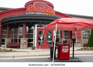 Raleigh, NC/United States- 03/18/2020: A Red Robin deploys an outdo curbside pickup station amid the COVID-19 epidemic. Interior dining was banned in North Carolina  by executive order on 03/17/2020.