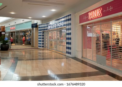 Raleigh, NC/United States- 03/18/2020: Shuttered retail stores are seen inside a deserted shopping mall. Many have closed voluntarily amid the coronavirus (COVID-19) outbreak.