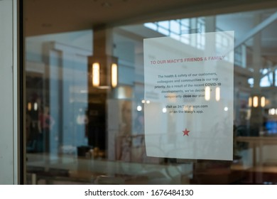 Raleigh, NC/United States- 03/18/2020: A sign hangs in front of a closed Macy's department store inside a mall. Macy's has voluntarily closed all retail locations amid the coronavirus epidemic.